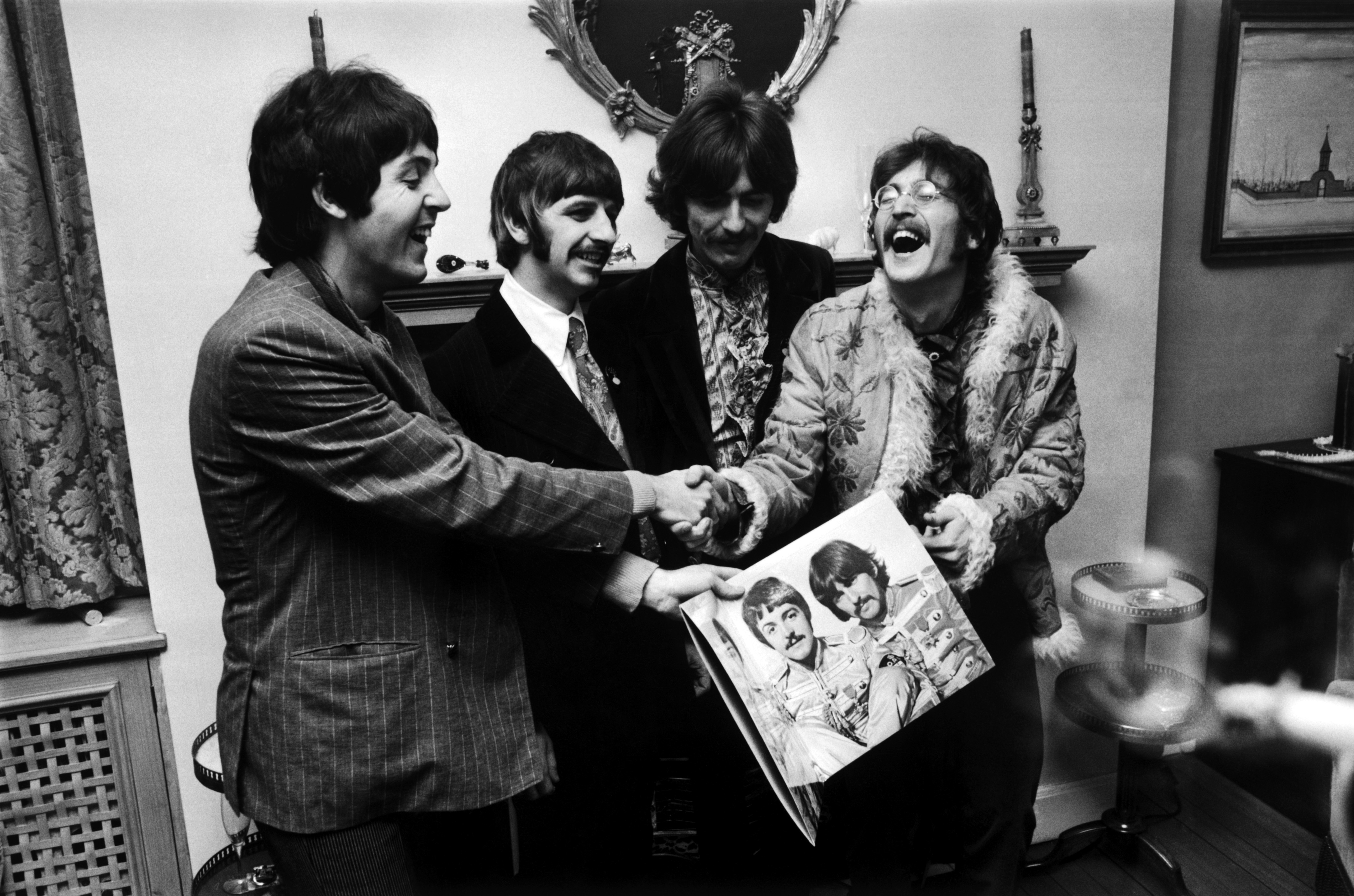 The Beatles hold the 'Sgt. Pepper's' album cover