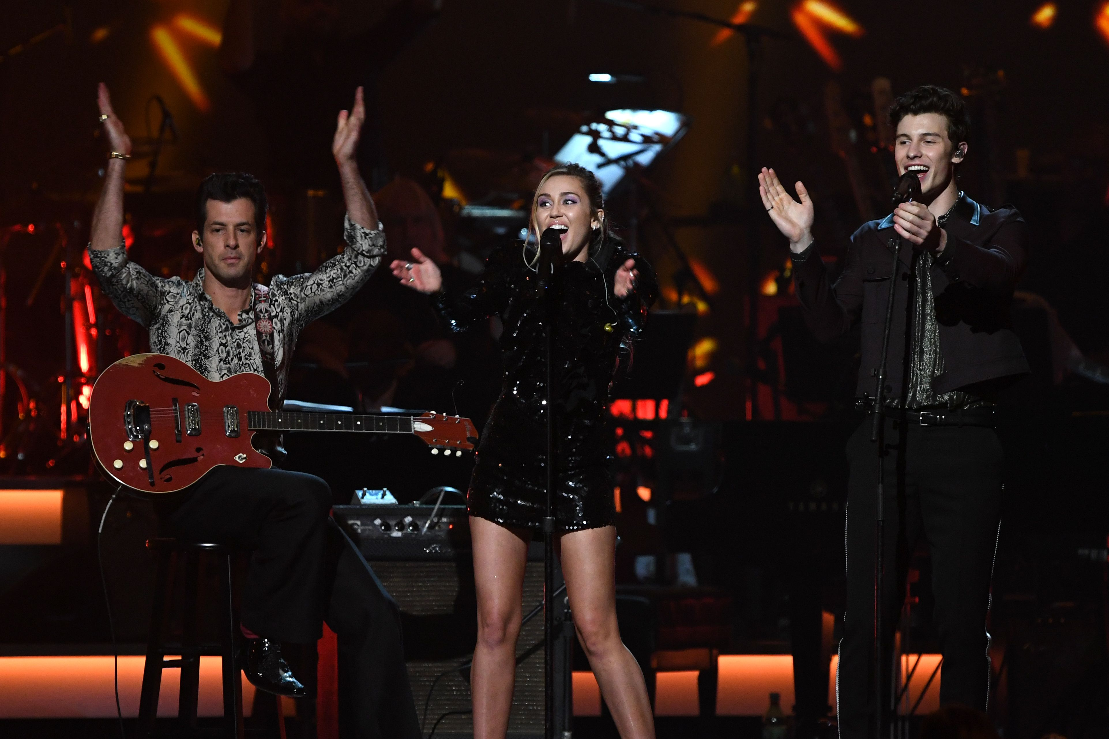 (L-R) Mark Ronson, Miley Cyrus and Shawn Mendes perform at the 2019 MusiCares Person Of The Year event