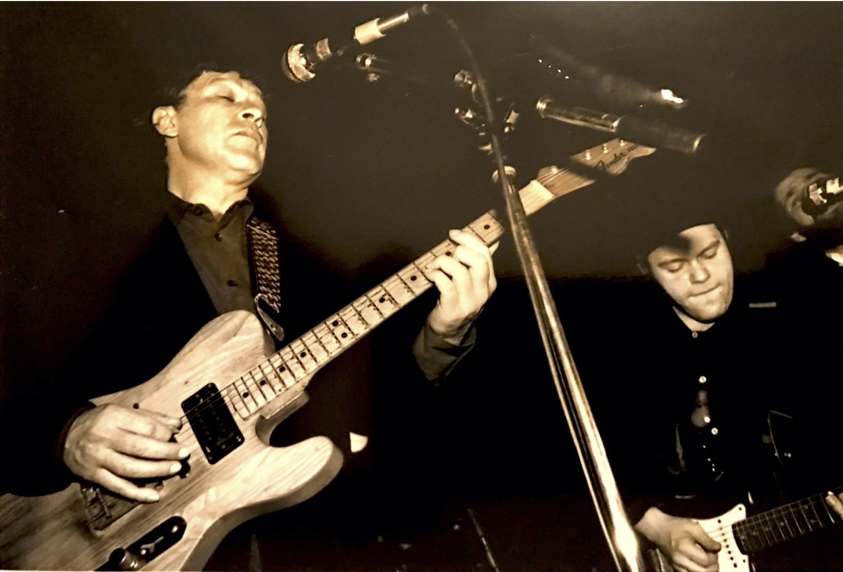 Colin Linden (R) with Robbie Robertson (L) performing at the Legendary Horseshoe Tavern in approximately 1989