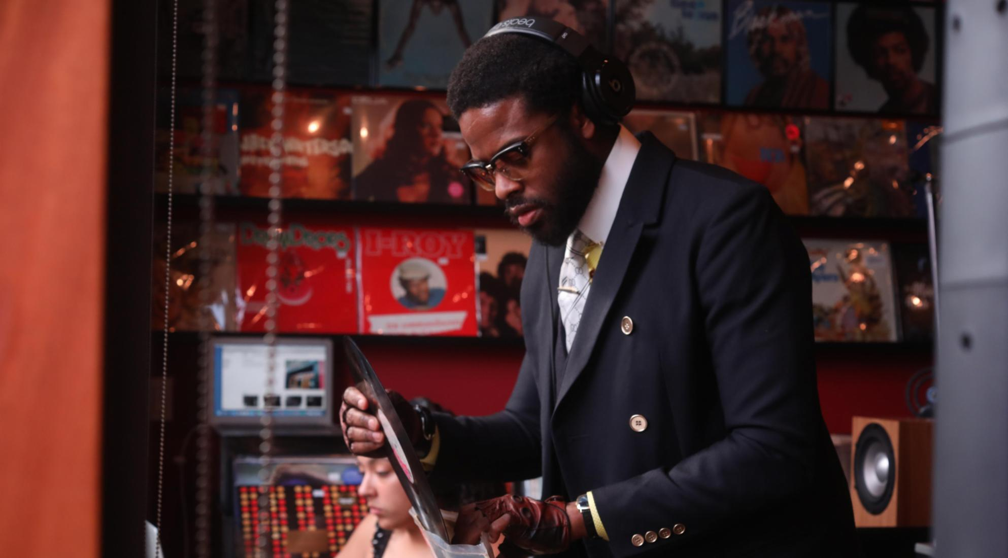Adrian Younge looks through a box of vinyl