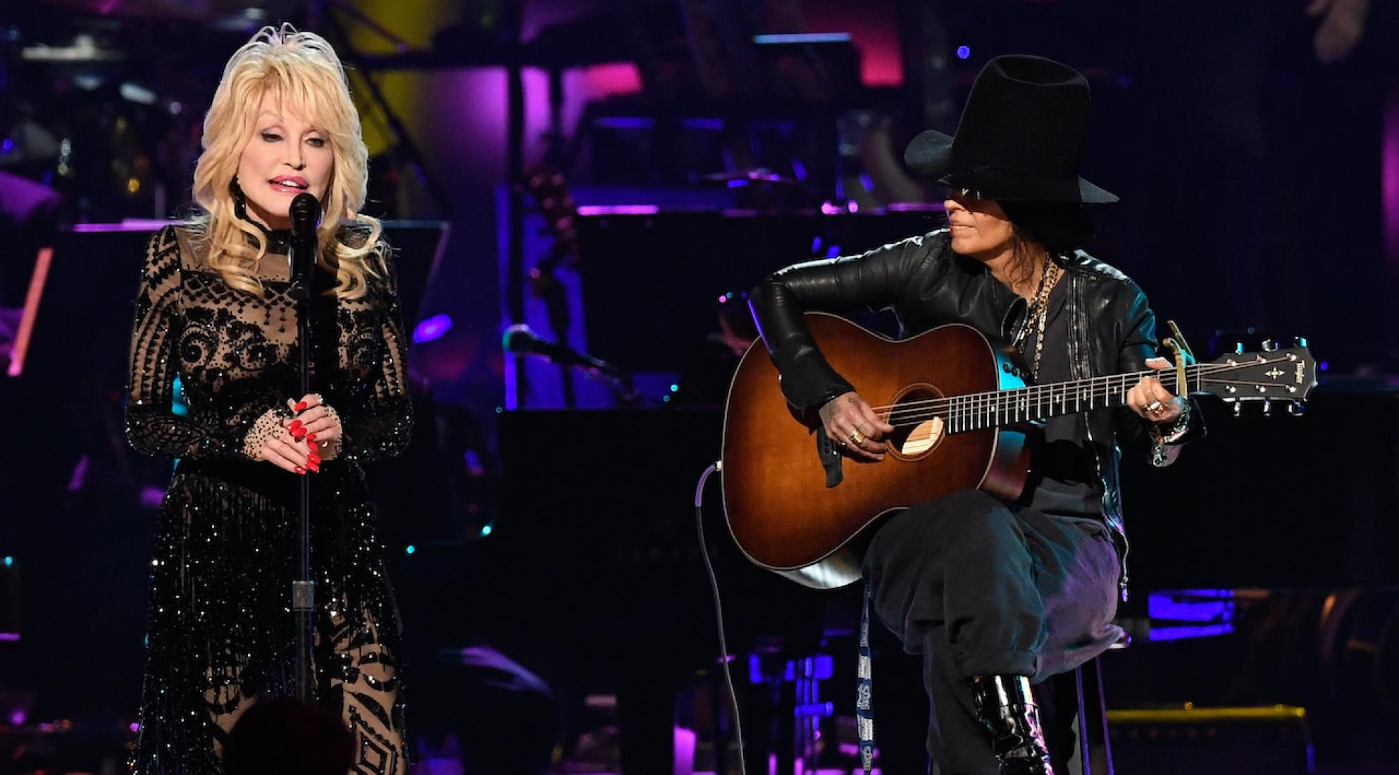 Dolly Parton (L) and Linda Perry (R) perform at the 2019 MusiCares Person of the Year event