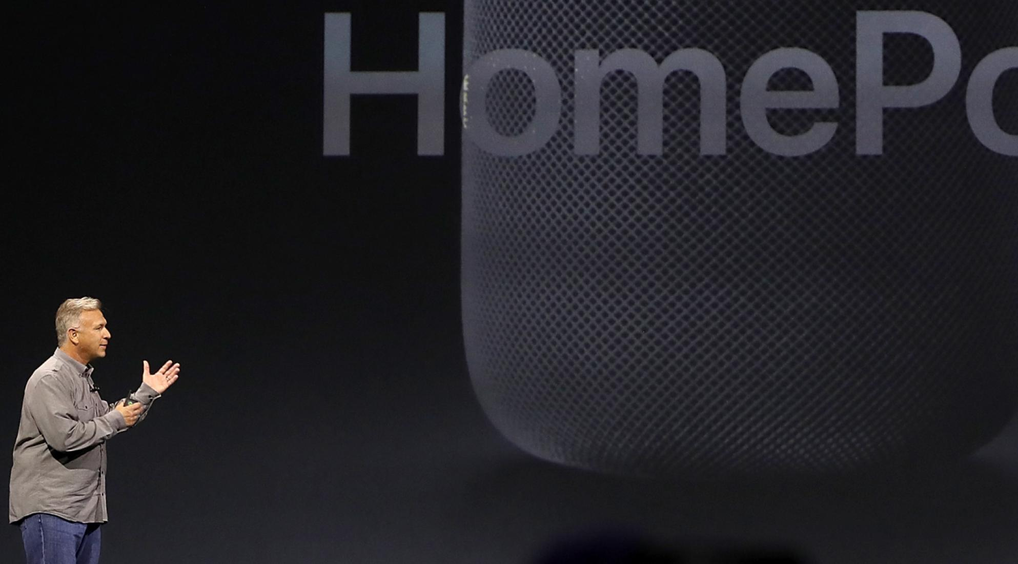 giant HomePod image projected behind speaker on stage