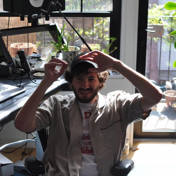 Baauer smiling in his at-home studio in Brooklyn