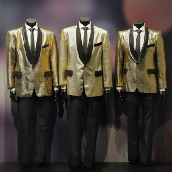 Boyz II Men's golden suits on display at the Motown exhibit