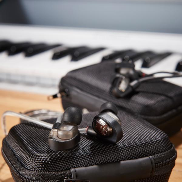 A pair of in-ear live sound monitors