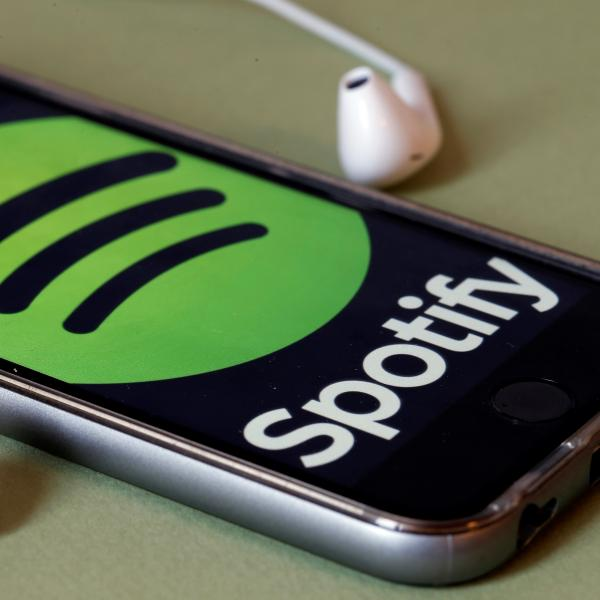 Spotify logo on phone with headphones