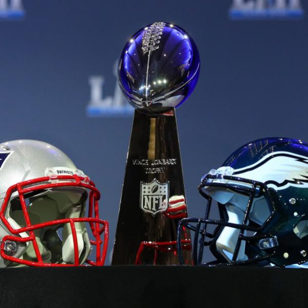 The Vince Lombadi Trophy and Patriots, Eagles helmets
