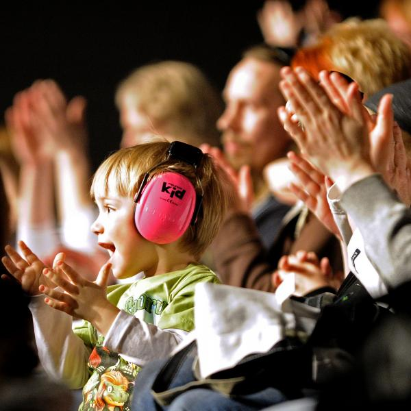 Children wearing hearing protection at a concert