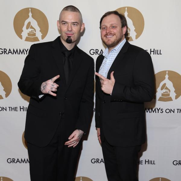Josh Abbott (R) with Paul Wall (L) at the 2016 GRAMMYs On The Hill Awards