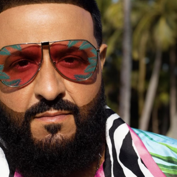 DJ Khaled poses in front of palm trees wearing colorful shirt & shades from his Dolce & Gabbana collab