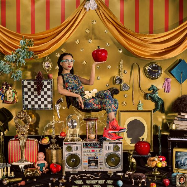 Esperanza Spalding sits atop a boombox in an elaborately decorated scene by photographer Holly Andres