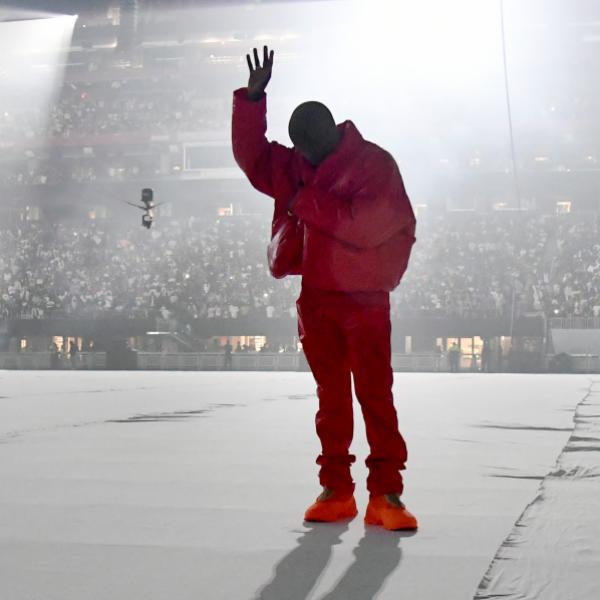 Kanye West poses in all red at 'Donda' listening event