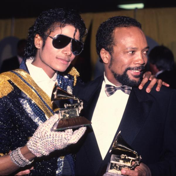 Michael Jackson, Quincy Jones, holding GRAMMY