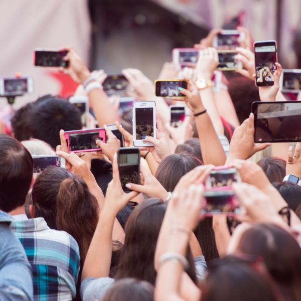 Fans holding up phones at a concert