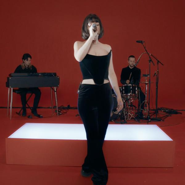 The Marías perform in a red room