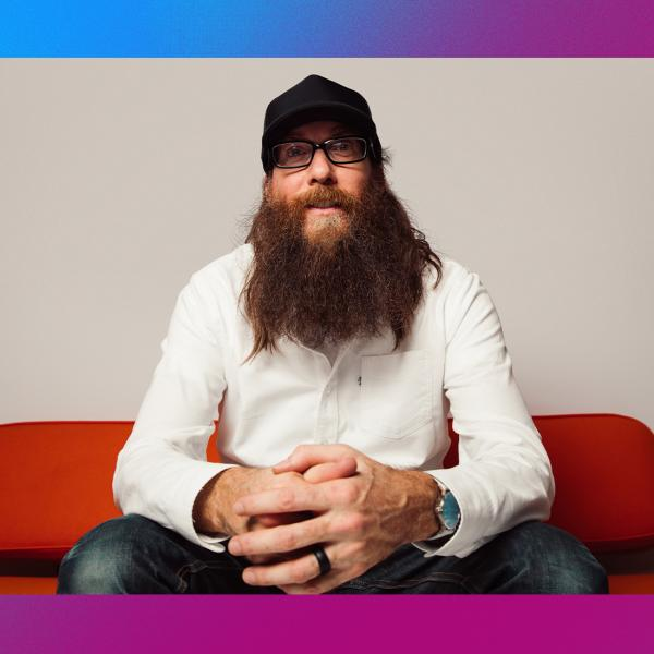 Photo of Crowder sitting on red couch