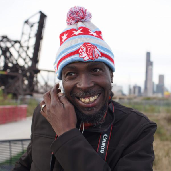 RP Boo smiles in front of Chicago skyline