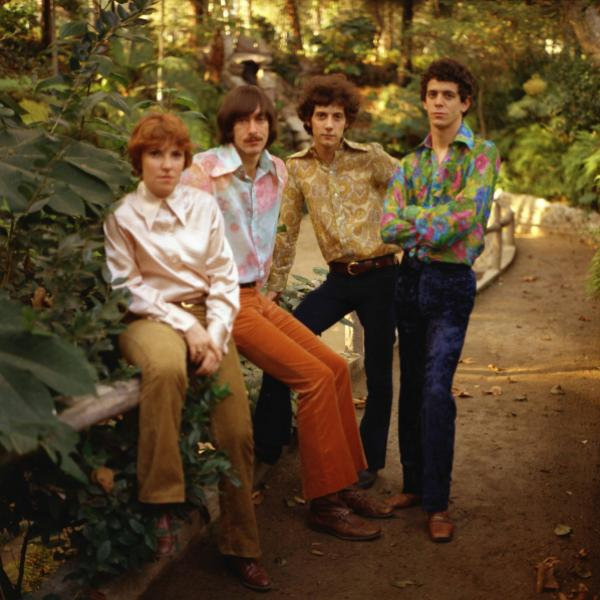 The Velvet Underground pose in a forest in colorful shirts