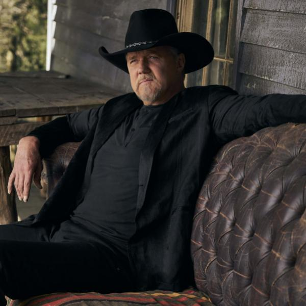 Trace Adkins poses on a leather couch in all-black