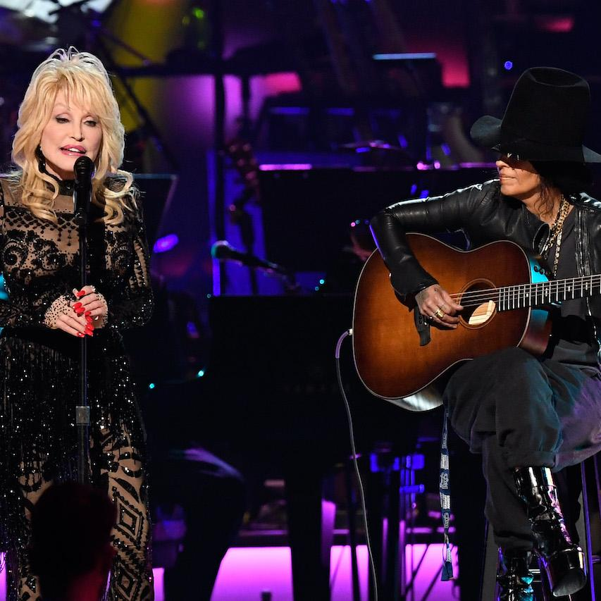 Dolly Parton (L) and Linda Perry (R) perform at the 2019MusiCares Person of the Year event