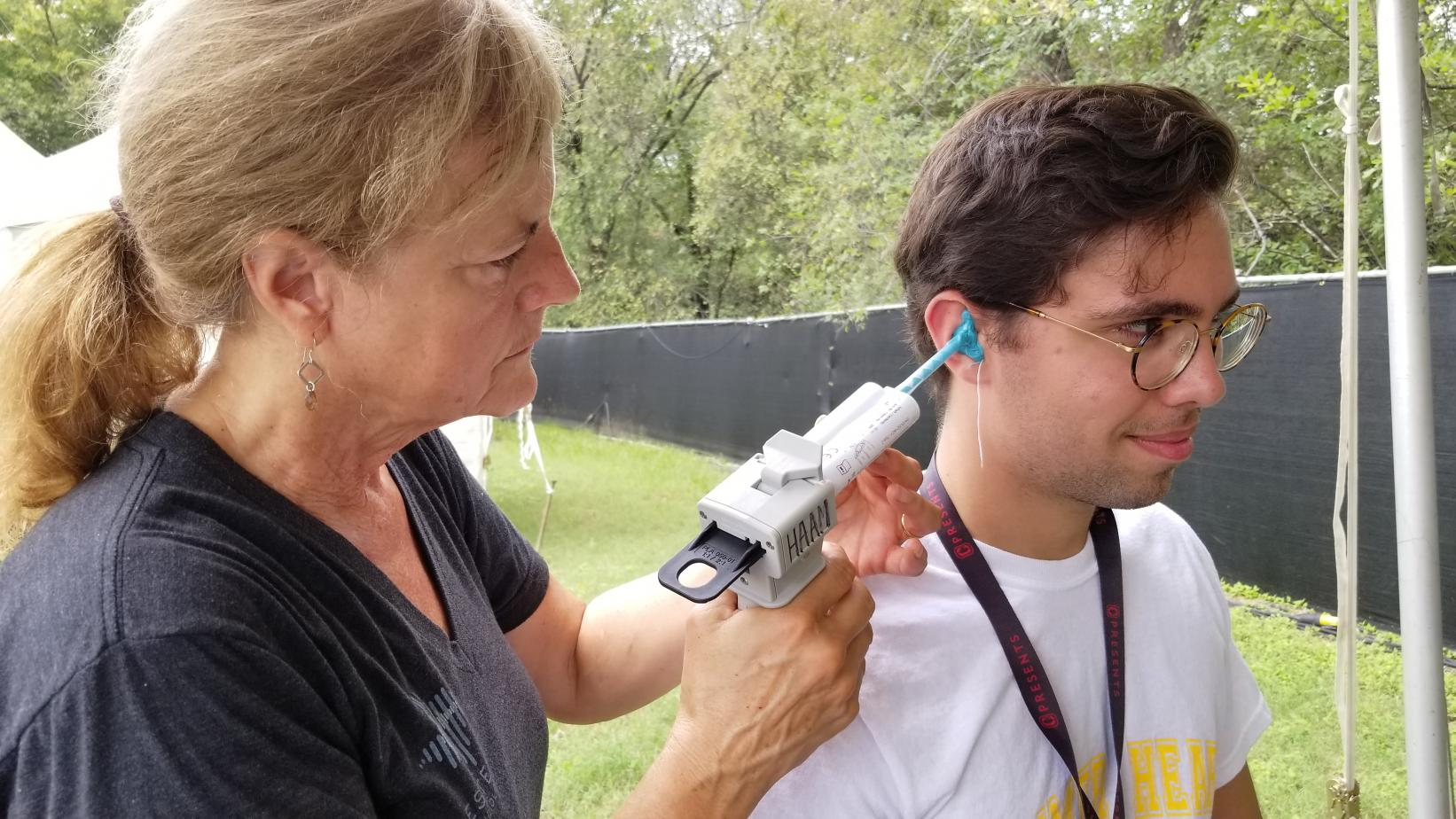 A MusiCares client receives custom molded earplugs