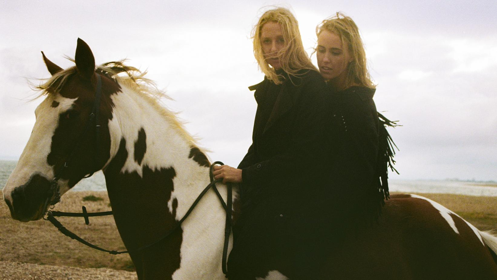 Eli & Fur pose on top of a horse