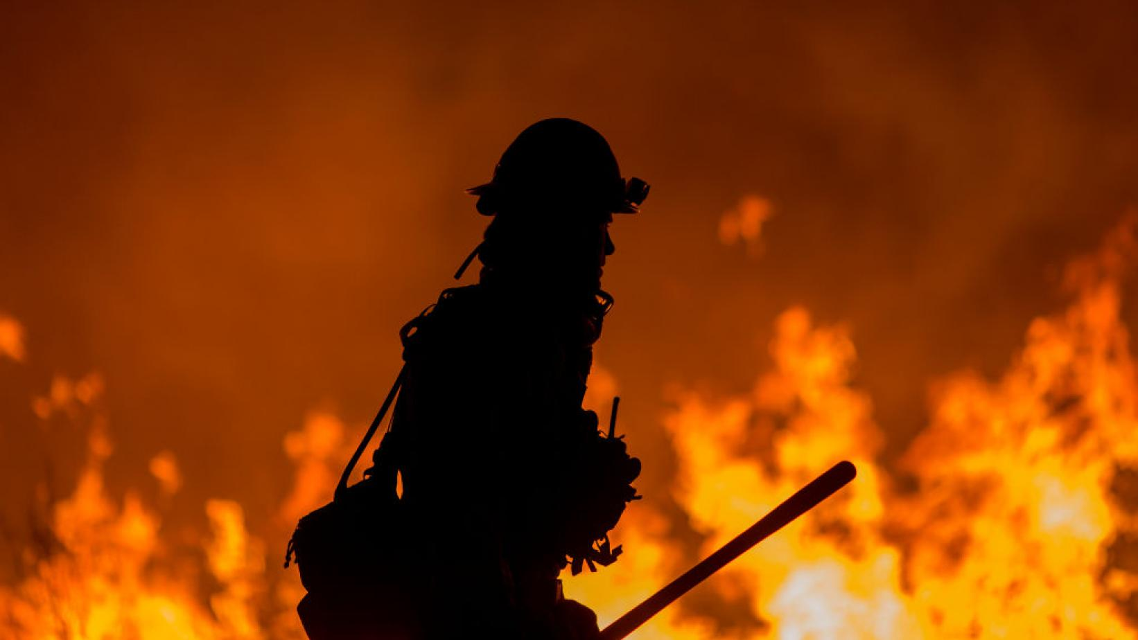 firefighter fights the Thomas Fire