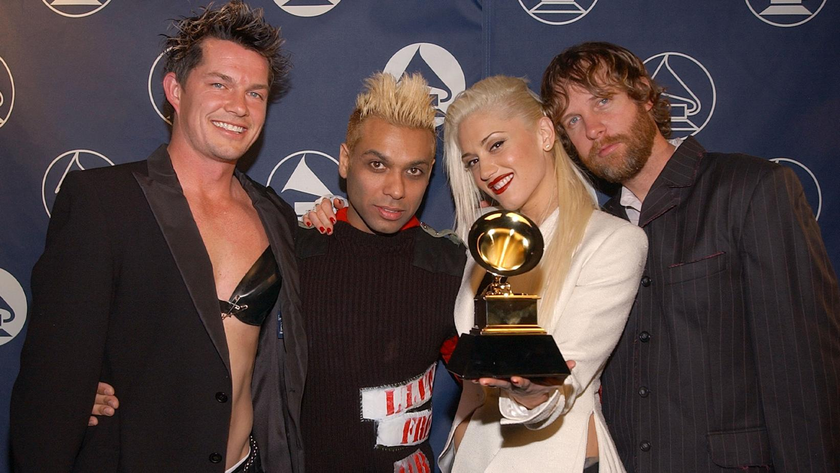 No Doubt pose backstage with GRAMMY at 2003 GRAMMYs