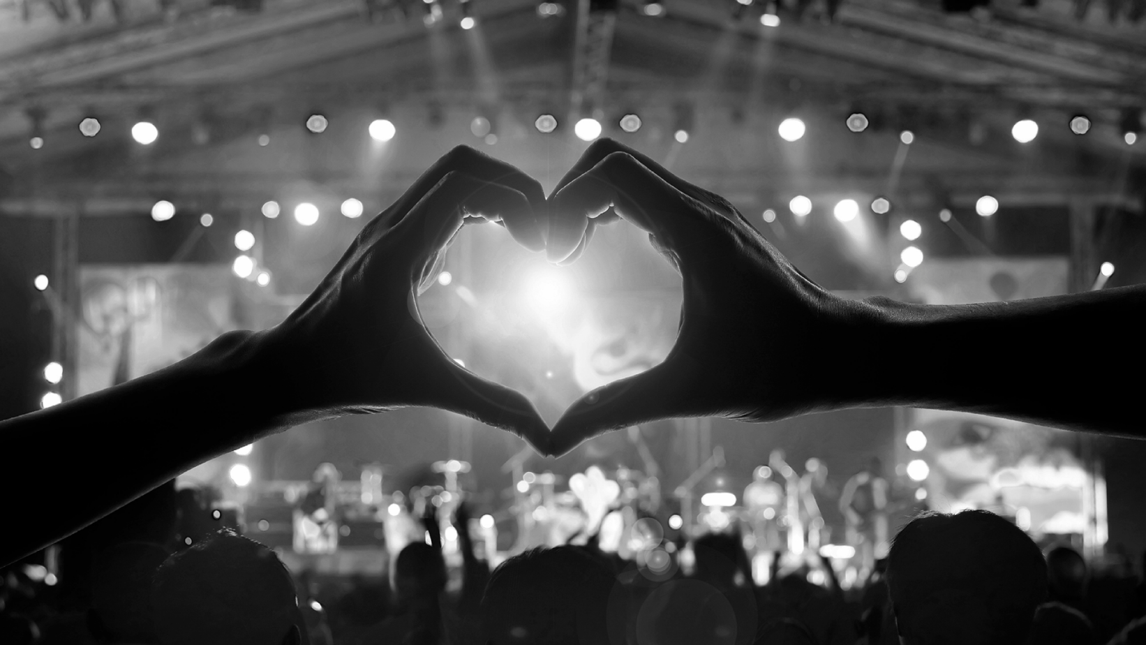Hands in the shape of a heart representing MusiCares Covid-19 campaign.