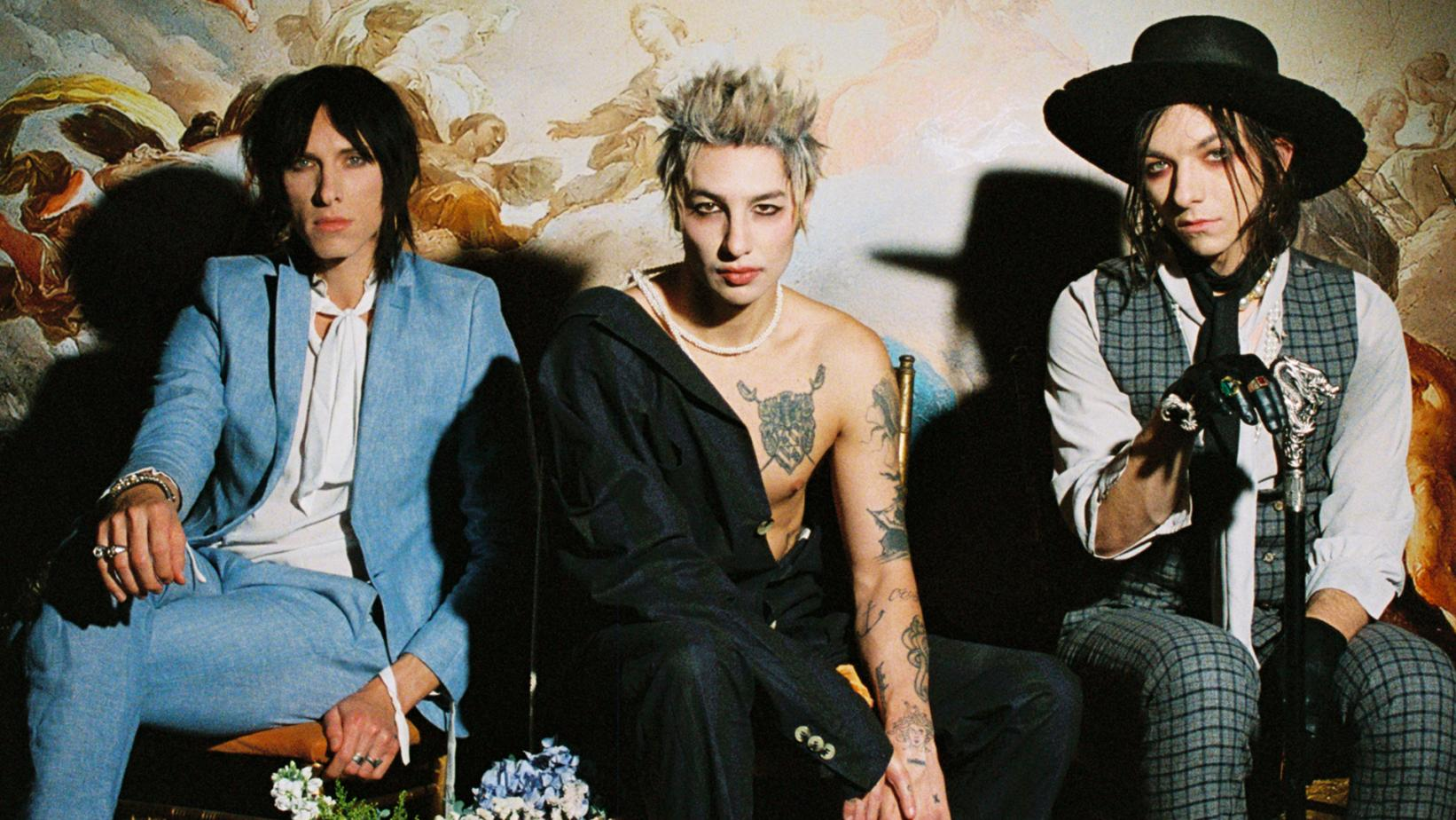 The three brothers of Palaye Royale pose together, seated