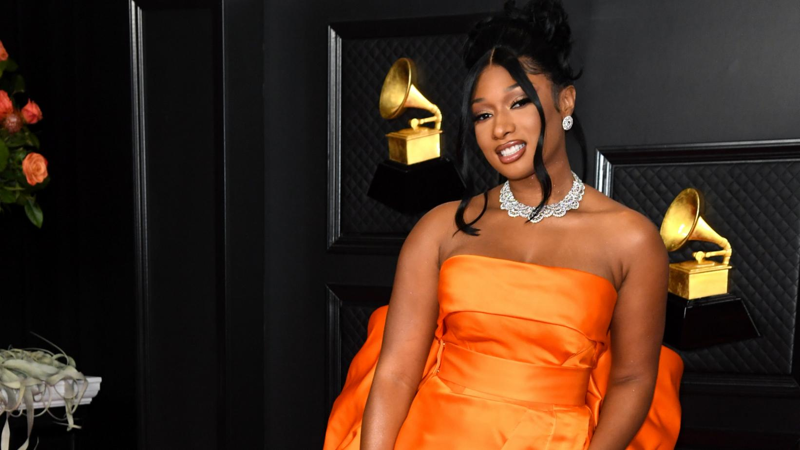 Photo of rapper Megan Thee Stallion posing on the 2021 GRAMMY Awards show red carpet