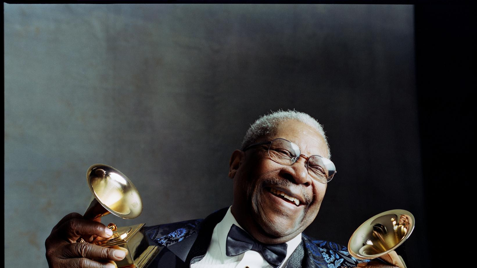 B.B. King holds two GRAMMYs