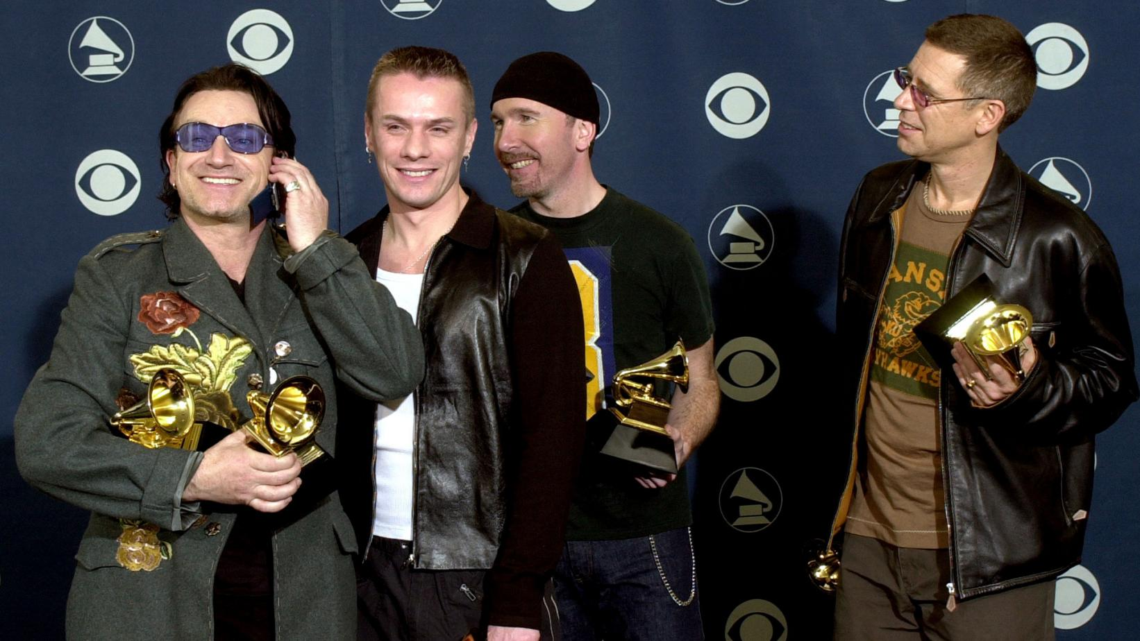 U2 pose with GRAMMYs backstage at the 43rd GRAMMY Awards in 2001