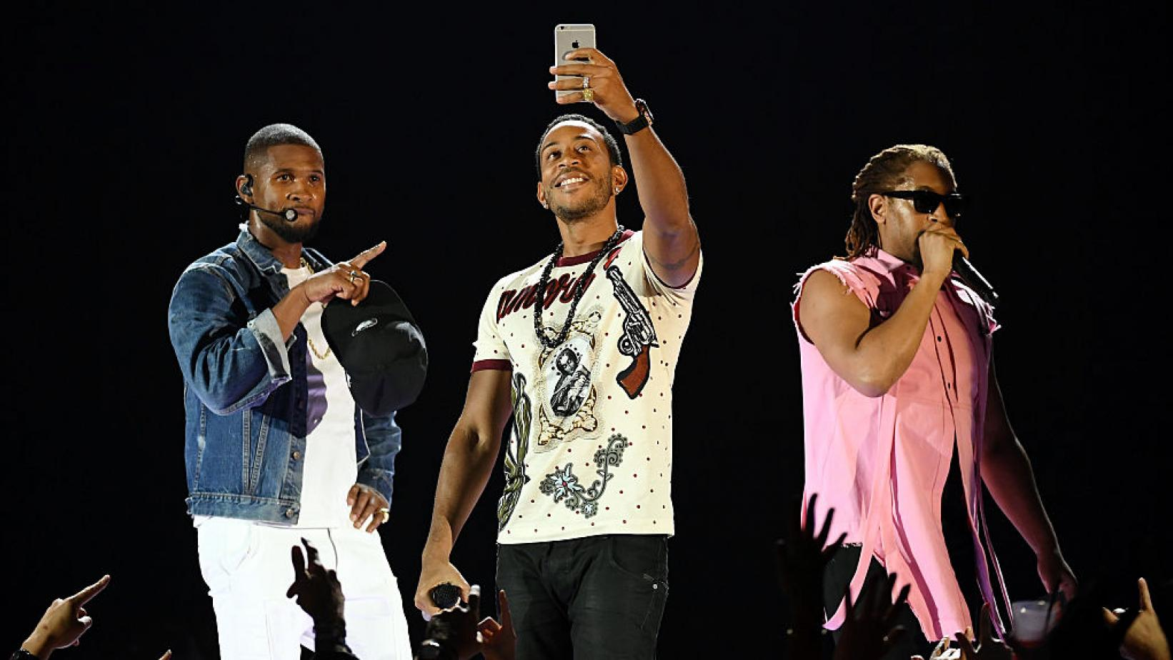 (L-R) Usher, Ludacris and Lil Jon perform at the 2016 iHeartRadio Music Festival