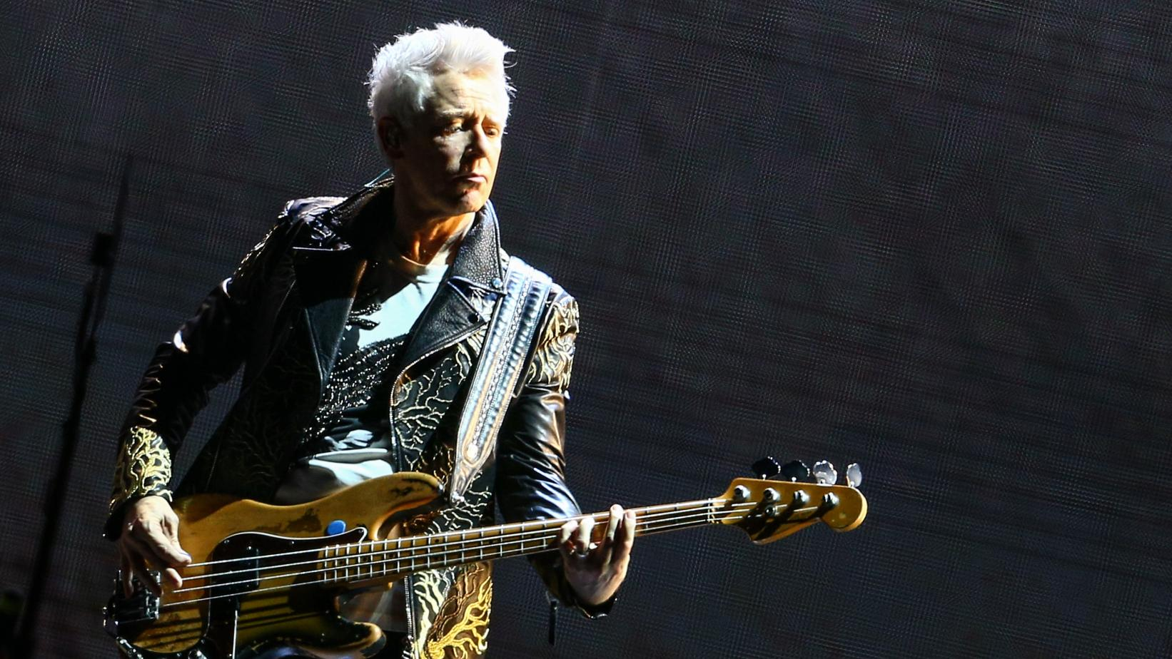 Adam Clayton performs live at the Rose Bowl in 2017