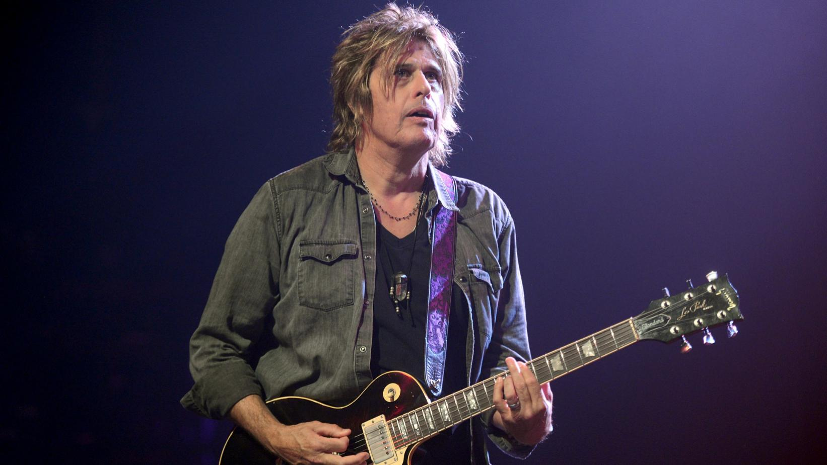 Dean DeLeo photographed onstage in 2017